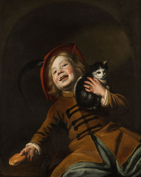 Boy with a cat, red hat and a piece of bread